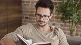 stubble : Businessman reading a book at home office