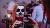 assustador : Portrait of woman in costume at halloween party Stock Footage
