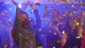 confete : Friends in costume dancing among the confetti at the halloween party