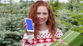 battlements : Red haired woman showing a mobile phone Stock Footage