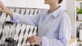 casual clothing : Happy, young woman making coffee in her home Stock Footage