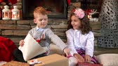 lareira : Siblings reading a book at fireplace Stock Footage