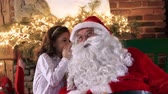 escondido : Girl whispering the hidden dreams for Santa Claus