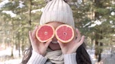 half : Woman covering her eyes with fruit Stock Footage