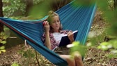 mentira : Woman lying on the hammock and reading book