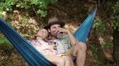 apaixonado : Couple in love relaxing on hammock in forest
