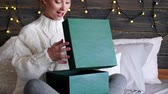 chocado : Surprised woman opening christmas presents