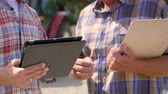 farmhouse : Part of modern farmers using a tablet on the farm Stock Footage