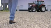 farmhouse : Low section of farmer walking on the farm Stock Footage