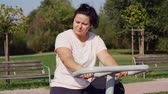 část : Woman using exercise bike in public park