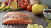 dining table : Raw salmon steak with lemon Stock Footage