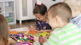 Children preparing decorations for Easter