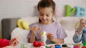 Close up of focused girl painting easter egg