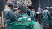 Time lapse video of busy surgeons over the operating table Dostupné videozáznamy