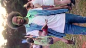multi colored : Swipe up video of African man in holi colors