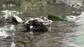 questões sociais : Close up of garbage in the river Stock Footage