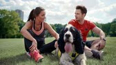 Happy couple and dog resting after hard workout