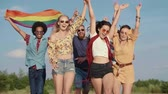 Happy friends with rainbow flag running outdoors Dostupné videozáznamy