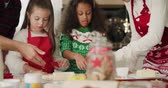 four children : Happy family baking cookies for Christmas