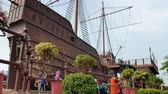реплика : Malacca,Malaysia -May 3,2019: People can seen exploring around the Maritime Museum Malacca. The museum main exhibits the replica of Flor de la Mar with 34 metres high, 36 metres long and 8 metres wide Стоковые видеозаписи