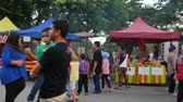カーニバル : Kuala Lumpur,Malaysia - June 2, 2019 : People seen exploring and buying foods around the Ramadan Bazaar.It is established for muslim to break fast during the holy month of Ramadan.