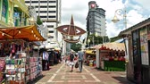 çarşı : Kuala Lumpur, Malaysia - June 2,2019 : Kasturi Walk is a covered, open-air flea market set along Jalan Kasturi, a lane running alongside Central Market. People can seen walking and shopping around it. Stok Video