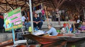 Ratchaburi,Thailand - November 5,2019 : Damnoen Saduak floating market is the most popular in Thailand, located 100 km from downtown Bangkok. People can seen exploring around by the boats.
