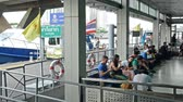 Bangkok,Thailand - November 8,2019 : People are waiting at the pier and getting around the famous riverside area of Bangkok with its many historical attractions, by river boats and ferries. Filmati Stock