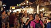Bangkok,Thailand - Nov 18,2019 :People can seen exploring and shopping around Ratchada Rot Fai Train Night Market.The night markets are a great way to get a slice of local life and eat authentic foods Filmati Stock