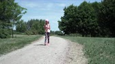 сотовый телефон : Girl walks while using smartphone 4K