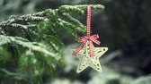 Christmas decoration star hanging on snowy fir tree, slom-motion HD