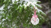 christmas tree ornament : Christmas decoration bauble hanging on snowy fir tree HD