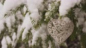 New Year Heart shaped Decoration hanging on fir tree 4K