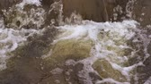 winter river : Small waterfall in river, slow motion Stock Footage