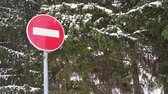 Snow falling in front of a stop sign in slow motion. Стоковые видеозаписи