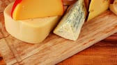 different cheeses : dairy food different cheeses served on wooding cutting board