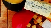 poroso : dairy product many delicious aged cheeses on wooden plate