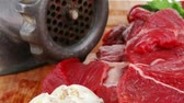 preparations : fresh raw beef meat slices over a wooden board with dill   green  and red hot peppers  and grinder isolated over white backkground Stock Footage