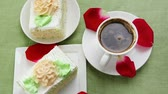 columbian : sweet breakfast : whipped cream cake with roses and hot black coffee Stock Footage