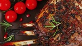 charbroiled : grilled ribs with cherry on dark plate