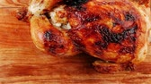 single roast : poultry : homemade roast whole turkey on wooden cutting board isolated over white background Stock Footage