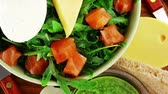 recipe : green salad with smoked salmon in green bowl on plate