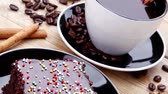 cinnamon sticks : sweet food : hot black fragrant coffee and chocolate cake with cinnamon sticks  coffee beans  and anise star