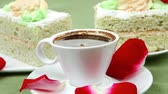 columbian : sweet food : milked cream cake with roses and hot black coffee cup