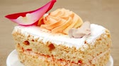 afters : sweet food: tender cream cake served with rose