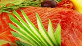 salmon pink : fresh smoked salmon fillet with vegetables and rosemary Stock Footage