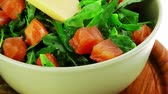 recipe : green salad with salmon and tomatoes in green bowl