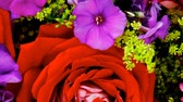 Флорес : flowers : big bouquet of rose and pansy flowers with green grass in red wrapping papper