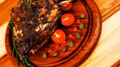 charbroiled : grilled ribs on wooden table with vegetables Stock Footage