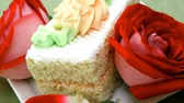 afters : sweet food: tender cheese cream cake served on white dish with roses
